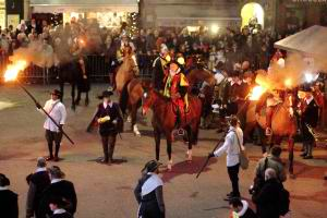 Escalade celebrations in medieval costumes, on the horses with torches.